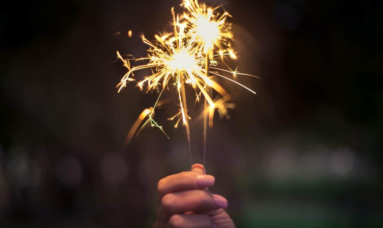 person holding a sparkler firework