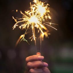 person holding a sparkler firework